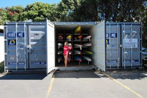 "alt= ""red beach surf lifesaving shipping container"""